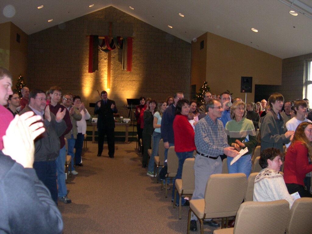 Post 9/11 memories - church members clap.